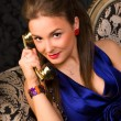 Young woman talking on phone — Stock Photo #1355567