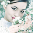 Young woman with cherry flowers portrait — Stock Photo