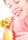 Young woman drinking fruit mix coctail — Stock Photo