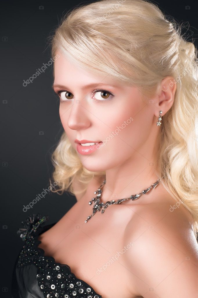 Young blond woman portrait. On dark background. — Stock Photo #1355399