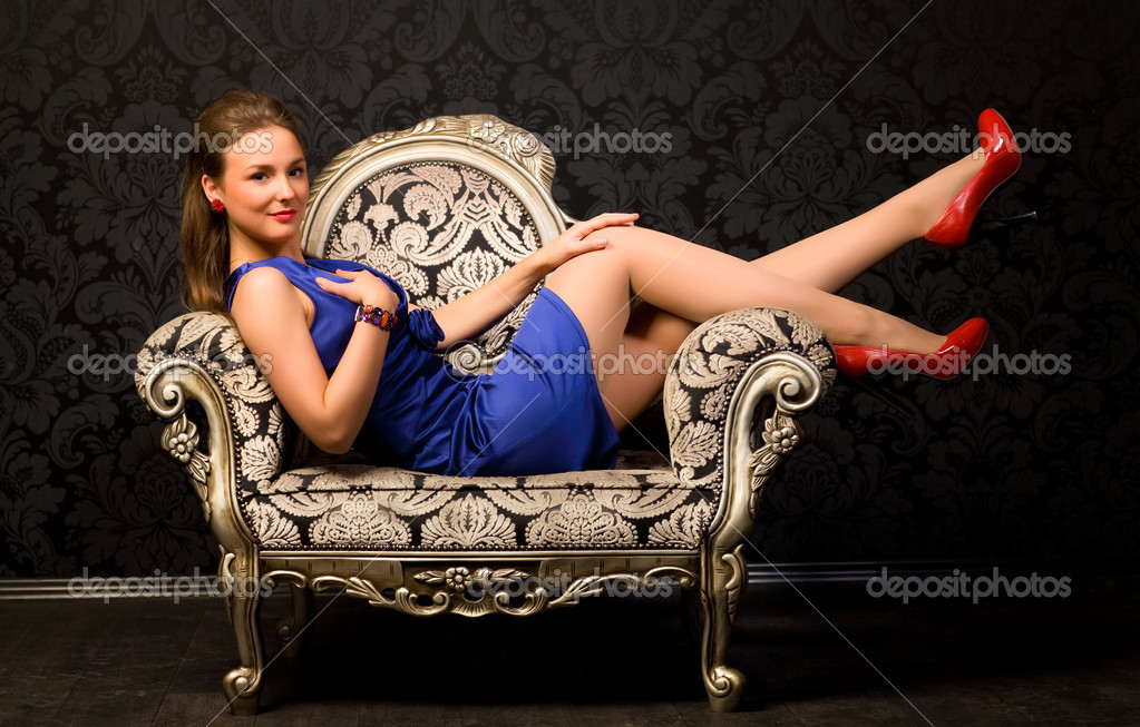 Young woman in a chair. Retro style. — Stock Photo #1355453