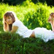 Stock Photo: Young woman lying on grass
