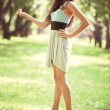 Young slim woman walking in a park — Stock Photo