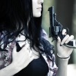 Woman with gun portrait - Stock Photo