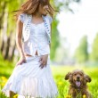 Young woman with cocker spaniel dog — Stock Photo