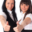 Two young women showing success handsign — Stock Photo #1368942
