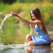 Young woman playing with water. — Stock Photo