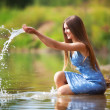 Young woman playing with water. — Stock Photo #1368972