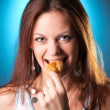Young woman eating patty portrait — Stock Photo