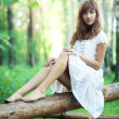 Young woman in forest — Stock Photo