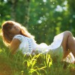 Young woman lying on grass — Stock Photo