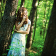 Young woman in forest — Foto de Stock