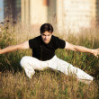 Young athletic man martial art training - Stock Photo