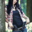 Young woman with guns - Stock Photo