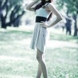 Young slim woman in a park — Stock Photo #1369146