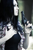 Woman with gun portrait — Stock Photo