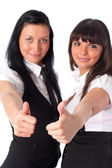 Two young women showing success handsign — Stock Photo