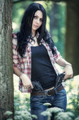 Young woman with guns — Stock Photo
