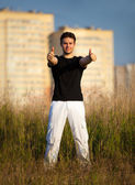 Young man showing success handsign — Foto Stock