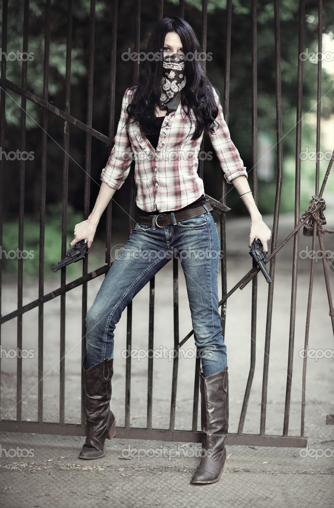 Young woman with guns. On metallic bar background.  Stock Photo #1362461
