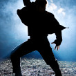 Dancing man silhouette — Stock Photo