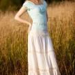 Young woman on a summer field — Stock Photo #1372691