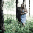 Young woman in a forest — Stock Photo