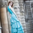 Young slim woman in dress - Stock Photo