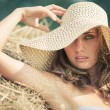Young woman in a hat portrait - Stockfoto