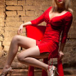 Young woman in red dress — Stockfoto