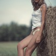 Young woman in a summer field — Stock Photo