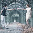 Young couple in a park stretching hands. - Stock Photo