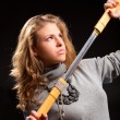 Young woman with samurai sword — Stock Photo
