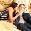 Young couple on a bed — Stock Photo