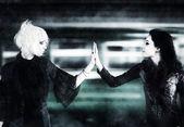 Two goth women touching hands — Stock fotografie