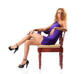 Young woman on a chair — Stockfoto