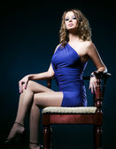 Young woman on a chair — Foto Stock