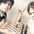 Young man and woman playing chess — Stock Photo