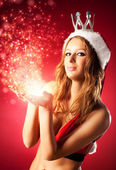 Young sexy woman in santa clothing — Stock Photo