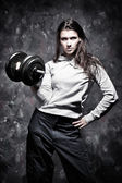 Young strong woman sport exercises — Stock Photo