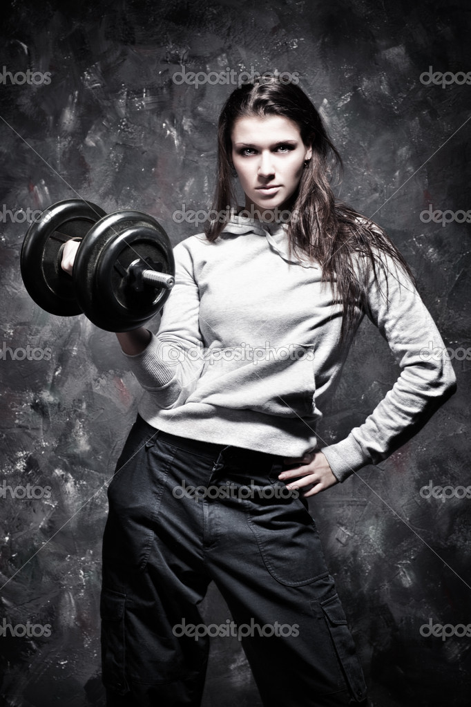 Young strong woman sport exercises. Contrast colors. — Stock Photo #1575557