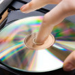 Royalty-Free Stock Photo: Insert CD into player