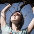 Girl holding at the branch - Stockfoto