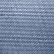 Stock Photo: Ribbed metal texture with blue tint