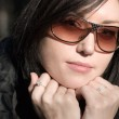Thoughtful portrait of woman in glasses — Stock Photo