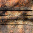 Old metal surface of a door with chinks - Stock Photo