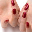 Woman red nails on both hands - 