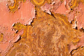 Rusty metal surface with pieces of paint — Stock Photo
