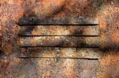 Old metal surface of a door with chinks — Stock Photo