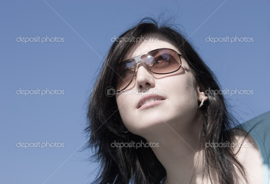 Skittish girl look. On blue sky background. — Stock Photo #1634828